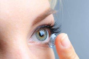 contacts eye close up woman - contact lenses fitting Carlsbad, CA
